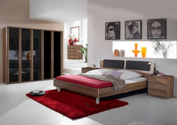 lovely-modern-bedroom-design-with-wooden-closet-feat-glossy-dark-glass-door-and-wooden-dress-cabinet-and-mirror-915x646
