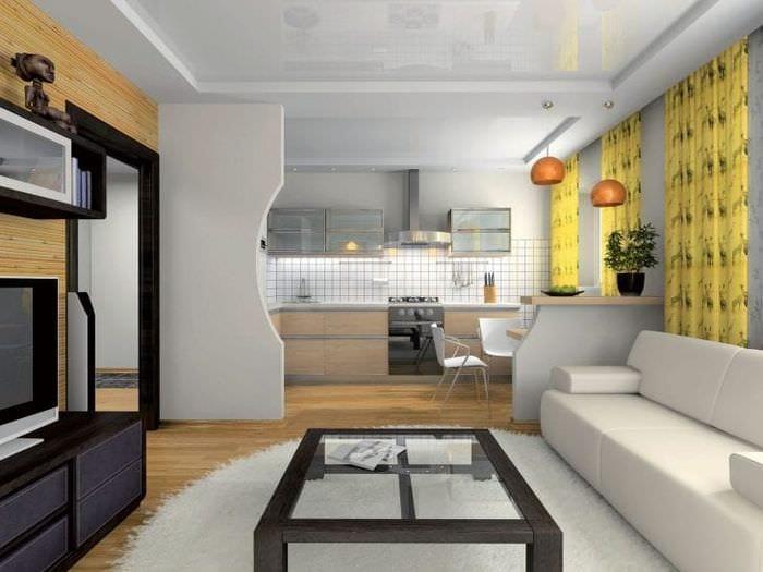 Дизайн большой и светлой комнаты с рабочими зонами для кухни и столовой