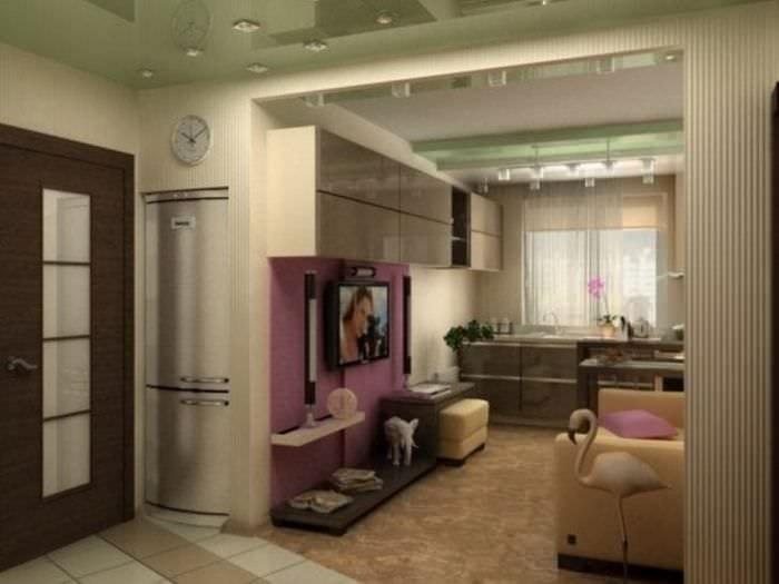 Интерьер небольшой кухни-гостиной в ярком розовом цвете