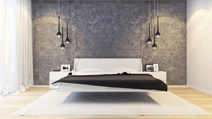 Просторная гостиная с темными стенами в стиле минимализма