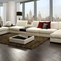 темный угловой диван в дизайне квартиры картинка