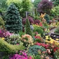 шикарный ландшафтный дизайн сада в английском стиле с деревьями фото