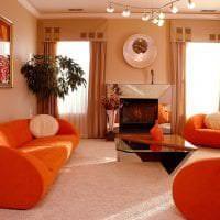 приятный терракотовый цвет в дизайне гостиной фото