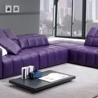 темный угловой диван в стиле гостиной картинка