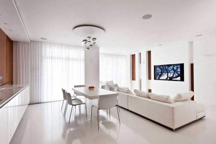 Интерьер белой гостиной в стиле минимализм фото