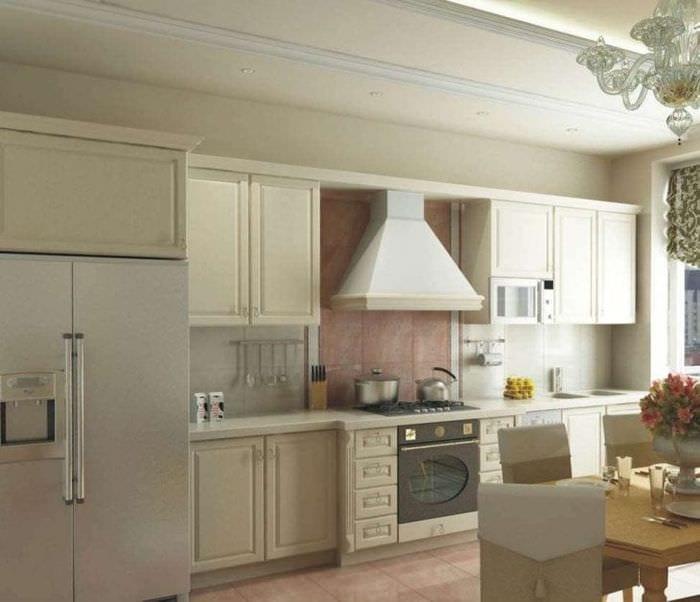 небольшой холодильник в интерьере кухни в белом цвете