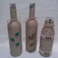 идея оригинального оформления бутылок шампанского шпагатом фото
