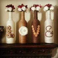 идея красивого украшения стеклянных бутылок шпагатом фото