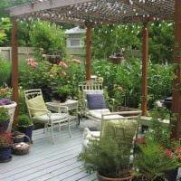 красивое создание дизайна загородного дома цветами картинка