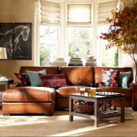 вариант необычного дизайна квартиры с диваном картинка
