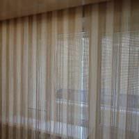 вариант красивых декоративных штор в интерьере квартиры фото