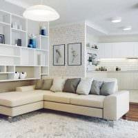 вариант оригинального интерьера кухни с диваном картинка