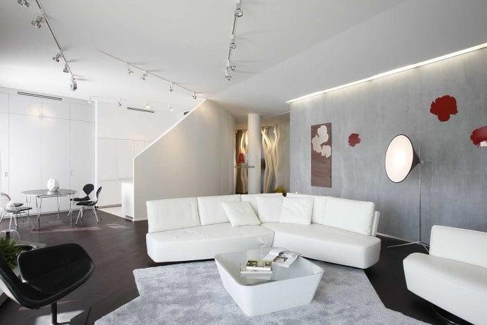 идея красивой декоративной штукатурки в дизайне гостиной под бетон