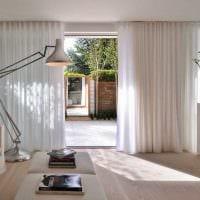 вариант красивого интерьера гостиной в стиле минимализм фото