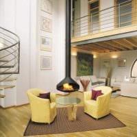 вариант яркого интерьера гостиной комнаты с камином картинка