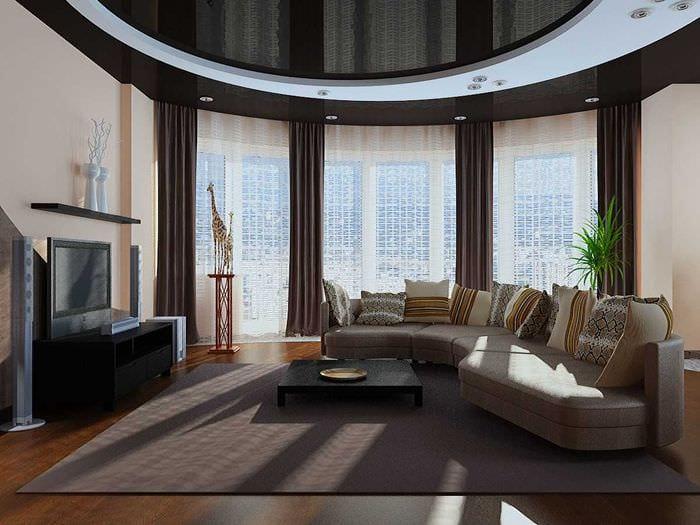 вариант необычного интерьера гостиной комнаты с эркером