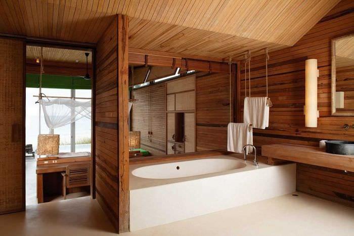 вариант современного интерьера ванной в деревянном доме