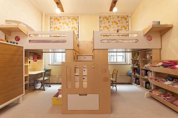 вариант красивого дизайна детской комнаты для двоих девочек