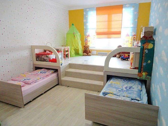 идея яркого стиля детской комнаты для двоих девочек