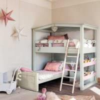 пример красивого интерьера детской комнаты для двоих детей фото