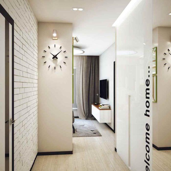 пример светлого интерьера прихожей в частном доме