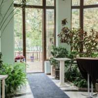 вариант применения необычных идей оформления зимнего сада в доме картинка