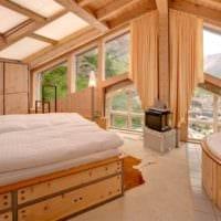 спальня в деревянном доме на мансардном этаже