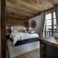 спальня в деревянном доме серо коричневые цвета