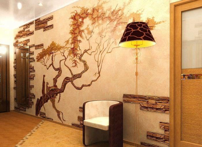 Декорирование стены в прихожей искусственным камнем