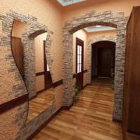 Сочетание камня и фактурной штукатурки на стене в прихожей