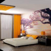 Панорамные фотообои в спальне с оранжевыми шторами