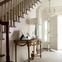 вариант необычного дизайна лестницы в честном доме картинка