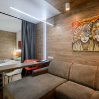 Дизайн квартиры студии с ламинатом на стене