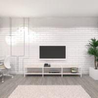 Белая кирпичная стена в интерьере однушки