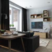 Черная оббивка дивана в дизайне однушки