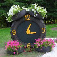 Клумба-часы из старых покрышек