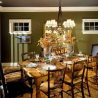 Сервировка праздничного стола в комнате с оливковыми стенами