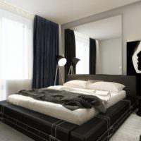 Софит на треноге в спальне с черной кроватью