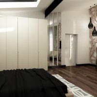 Белые стены и черное покрывало кровати