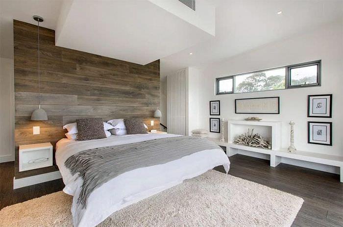 Декорирование стены над изголовьем кровати ламинатом