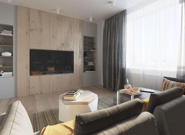 Стильный дизайн гостиной комнаты в квартире холостяка