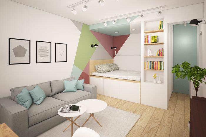 Кровать на подиуме в дизайне однокомнатной квартиры