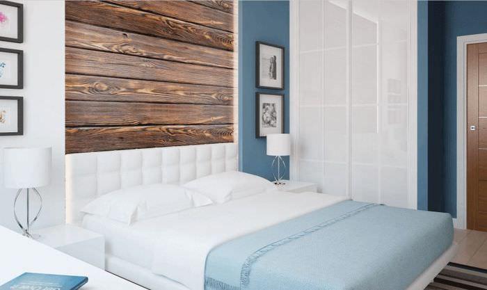 Отделка стены за кроватью панелями ламината