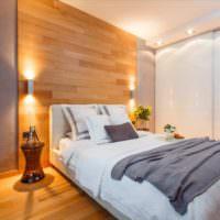 Оформление ламинатом стены в спальне