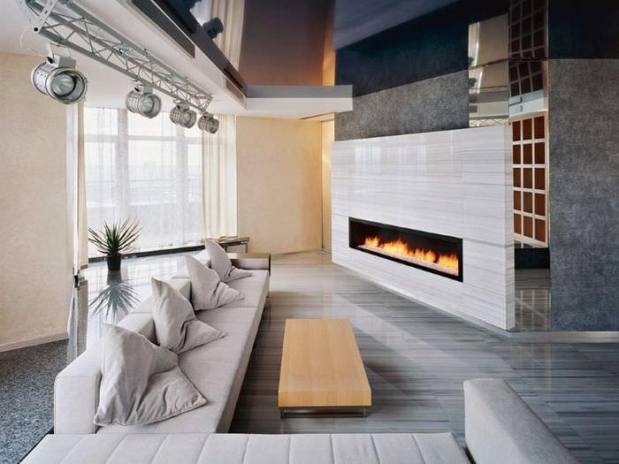 Интерьер гостиной в стиле хай-тек с серым ламинатом