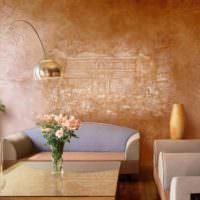 Украшение стены над диваном гипсовой лепниной