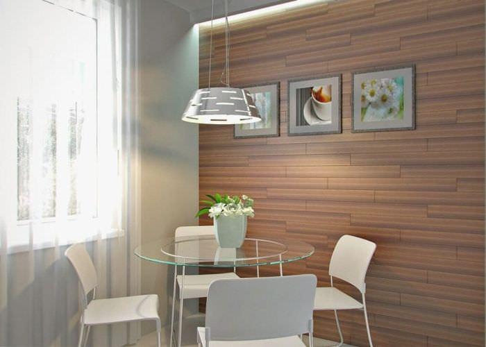 Круглый стеклянный стол на современной кухне