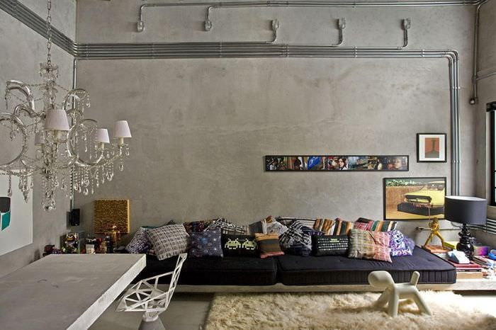 Неотделанный бетон в оформлении комнаты в стиле лофт