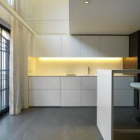 Белый гарнитур на кухне в стиле минимализма