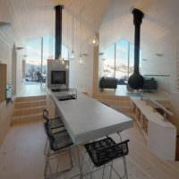 Интерьер гостиной частного дома с металлическими печками